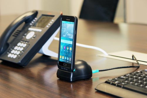 RAM Desktop Dock Charger with GDS Technology™ for RAM IntelliSkin™ Products in use