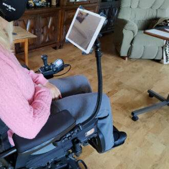 RAM Mount Wheelchair Mount on Armrest with Swivel for 10 Tablet in use